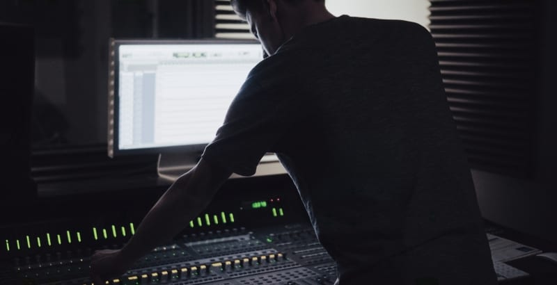 producer working in his home studio. What is remix? Remix definition and remix benefits
