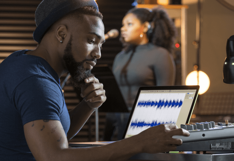 Producer working in the studio Beginner's guide to sync