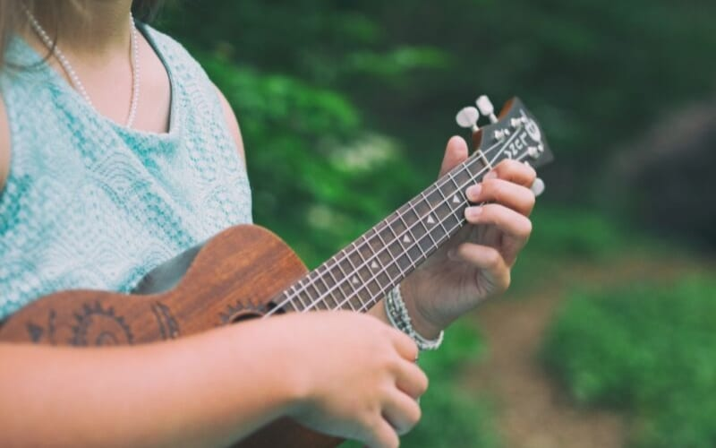 woman playing a ukulele in the woods, Ukulele Chord progressions