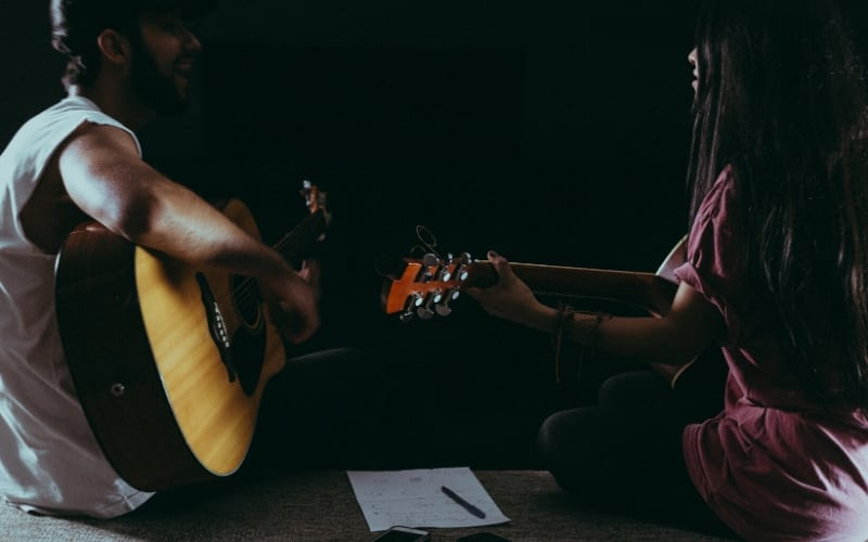 two people songwriting Best songwriting tips