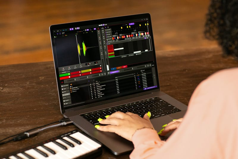 Serato Beat Maker - lady on a laptop editing soundwave beats whilst songwriting