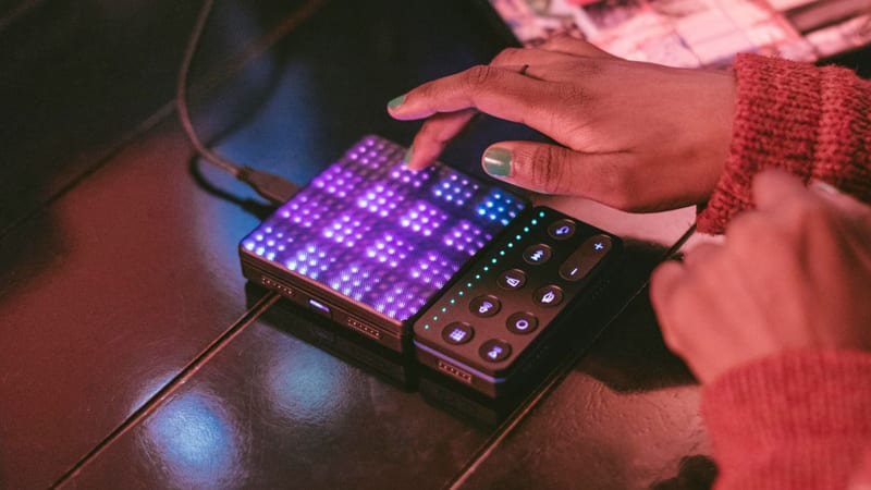 Roli Beat Maker - black female music producer playing and recording beats on table