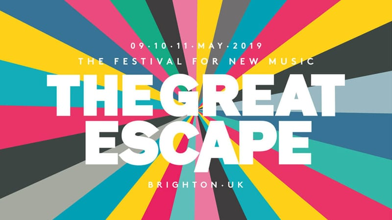 The Great Escape logo in May each year with zoom out colour display behind text in brighton, UK