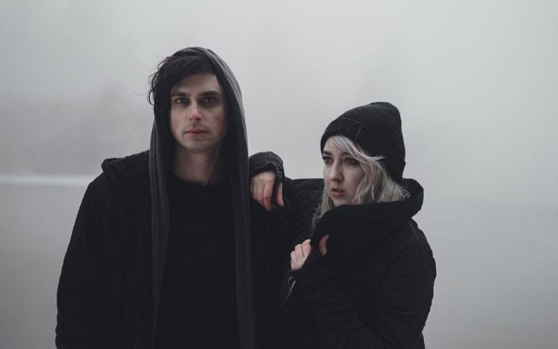 Man and woman in fog, black clothes Future Moons