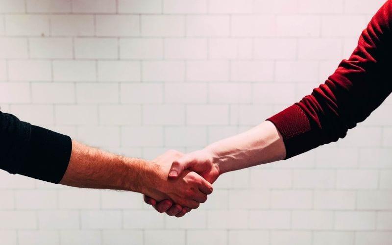 Men shaking hands to make a good impression
