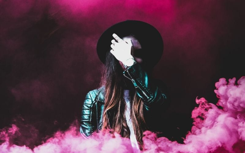 Woman in pink smoke A&R is what is needed to start a record label