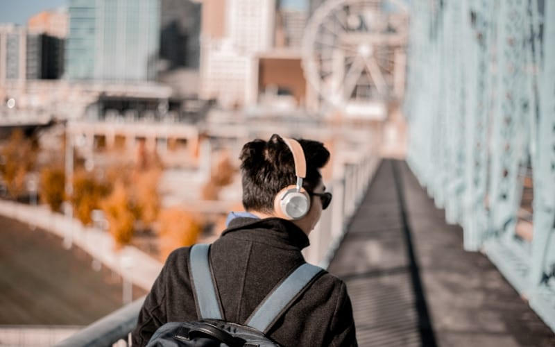 Man listening to music on headphones Music Gateway