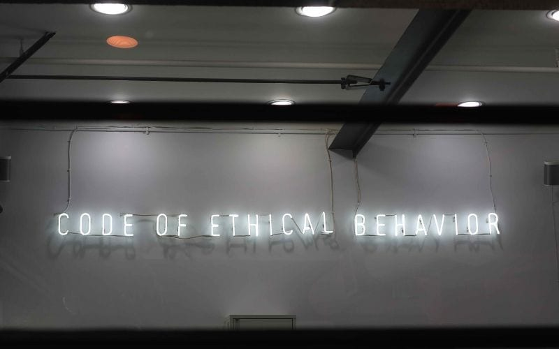 Code of ethical behaviour sign on wall during pandemic