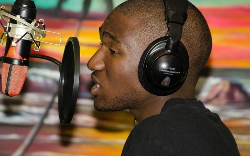 Man recording vocals for free sample packs
