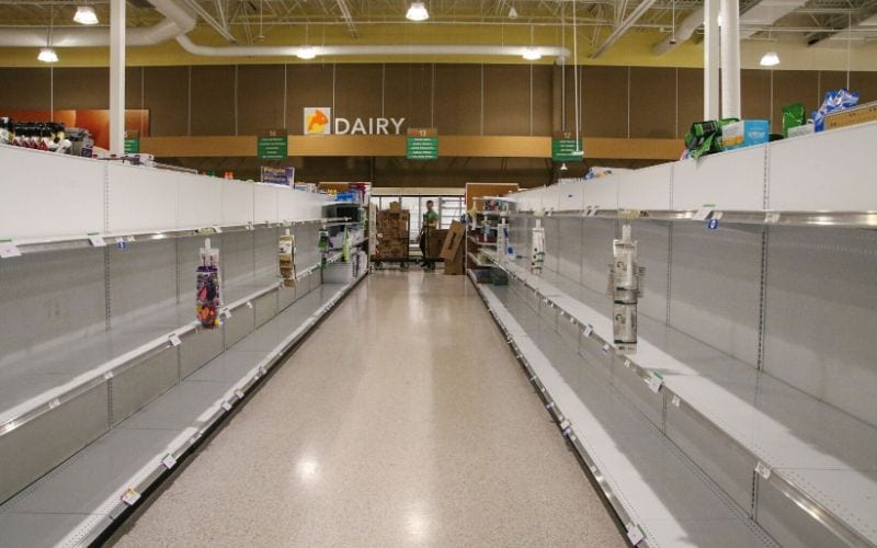 supermarket with empty shelves during pandemic