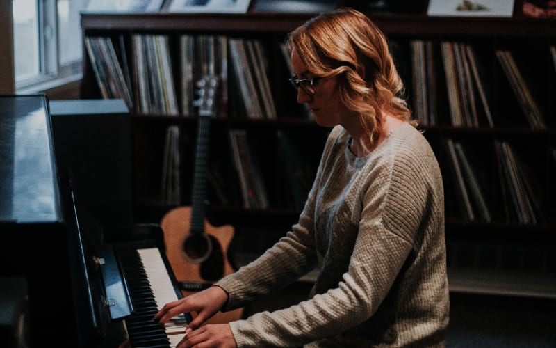 Woman playing piano songwriting