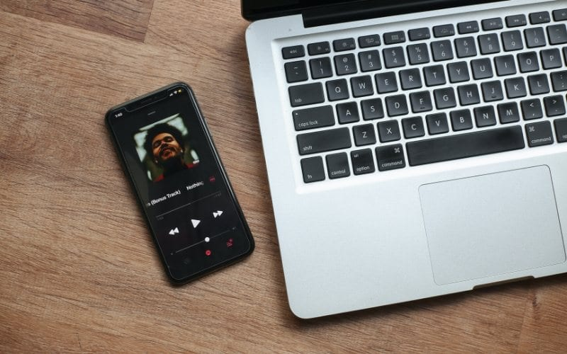 Laptop and music streaming service on phone Music Gateway