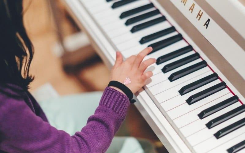 woman playing piano Music Gateway