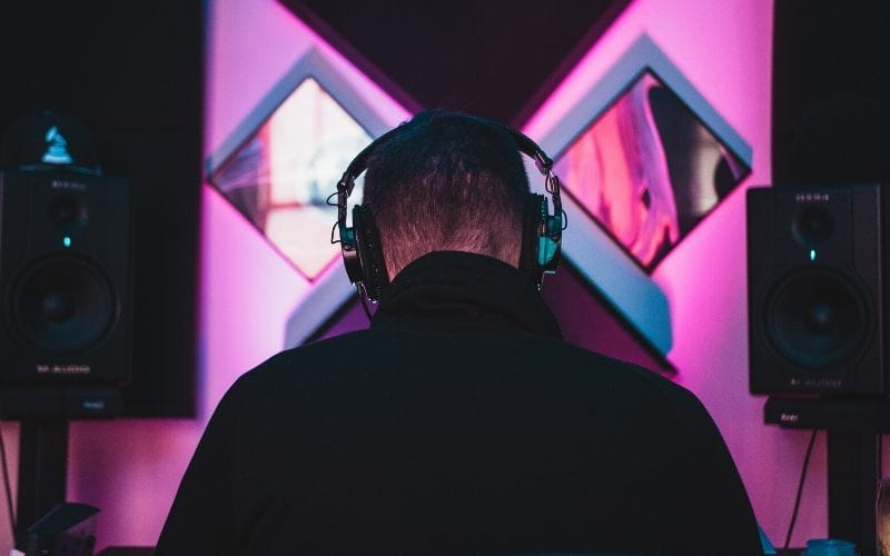music producer with headphones in studio Music Gateway