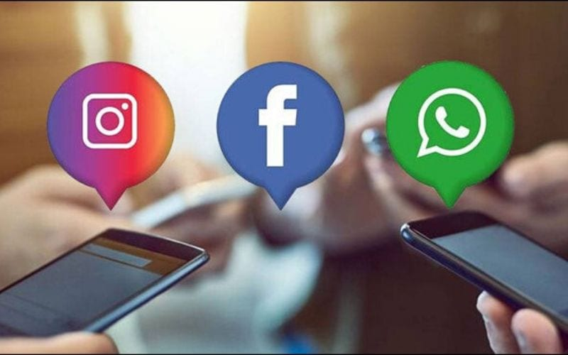 Instagram Facebook and Whatsapp logos with phones