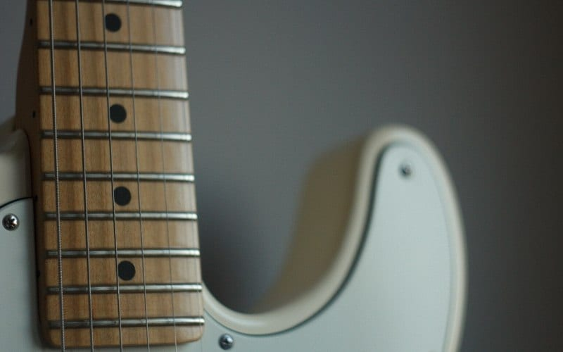 frets and fretboard of an electric guitar