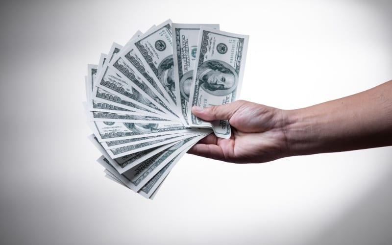 Man holding money Music Gateway