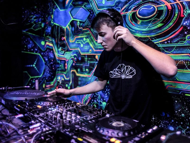 DJ with headphones and colourful background using audio compression