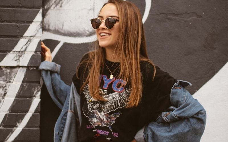 women wearing band tee, merchandise is part of a music branding strategy