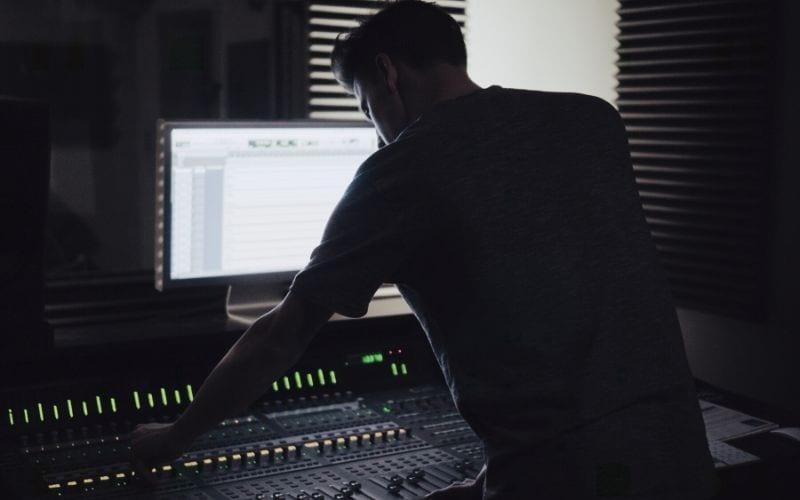 Man at mixing desk