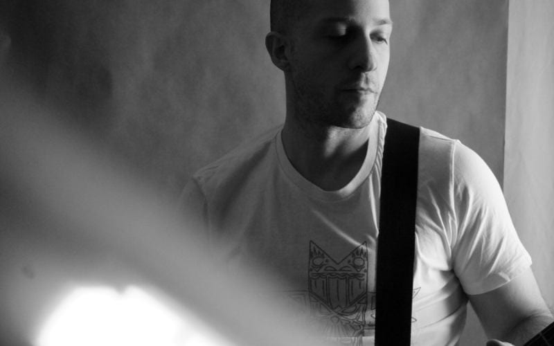 Man playing guitar black and white for his EPK