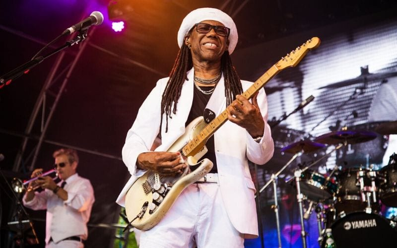 Nile Rodgers playing guitar on stage