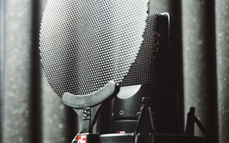 Pop shield on mic for vocal recording