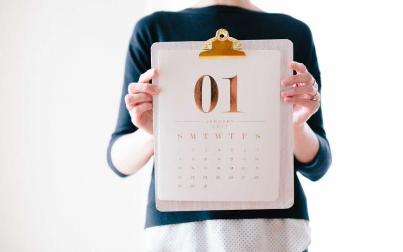 Women holding up calendar