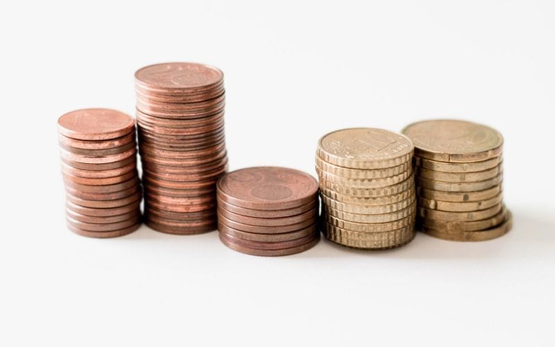 Euro coins stacked on white background royalties from neighbouring rights