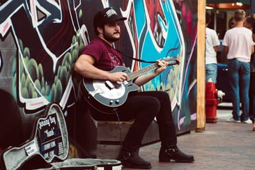 What is Busking & How Can You Benefit from Doing It?