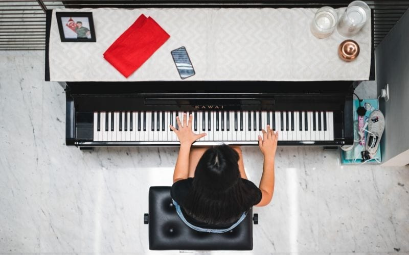 aerial shot of woman playing piano