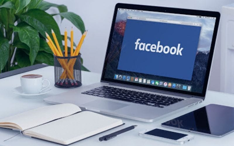 laptop with facebook on screen