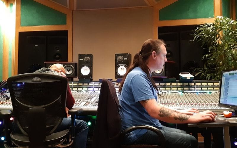 Man at mixing desk inside RAK Studios