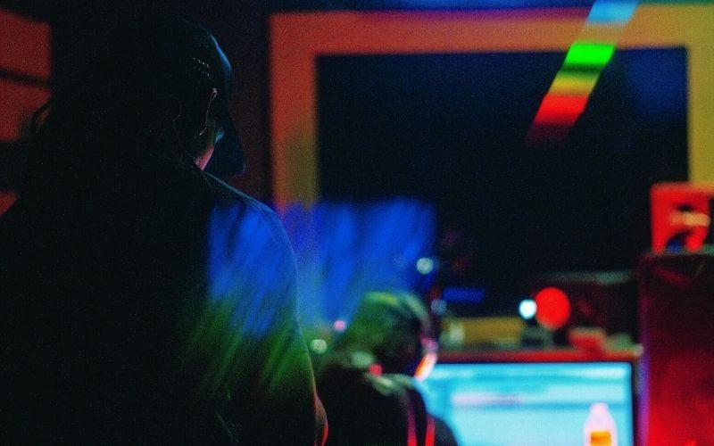 man wearing headphones music producer using HOFA