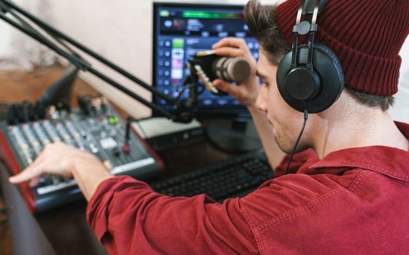 man recording mixing music