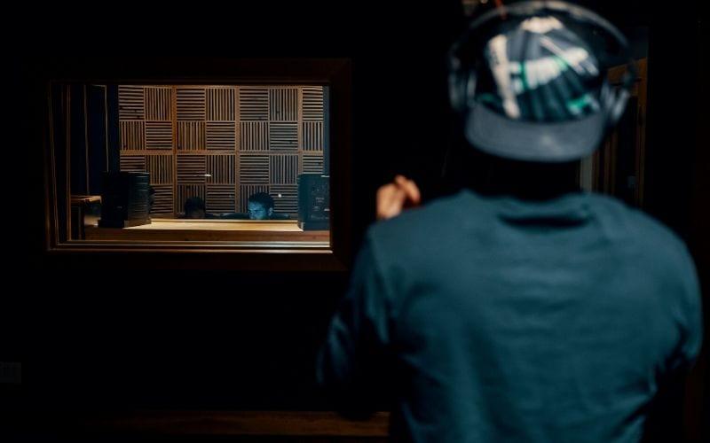 man recording music in studio