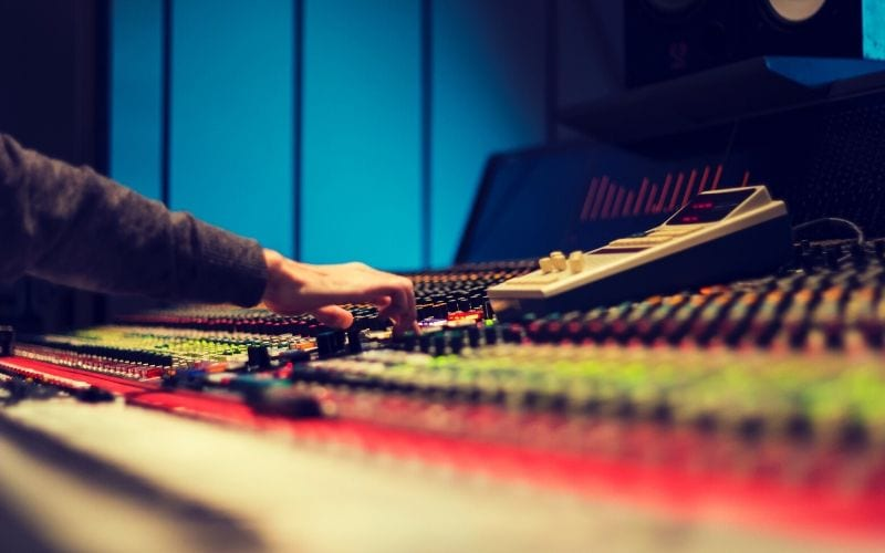 music producer in studio mixing