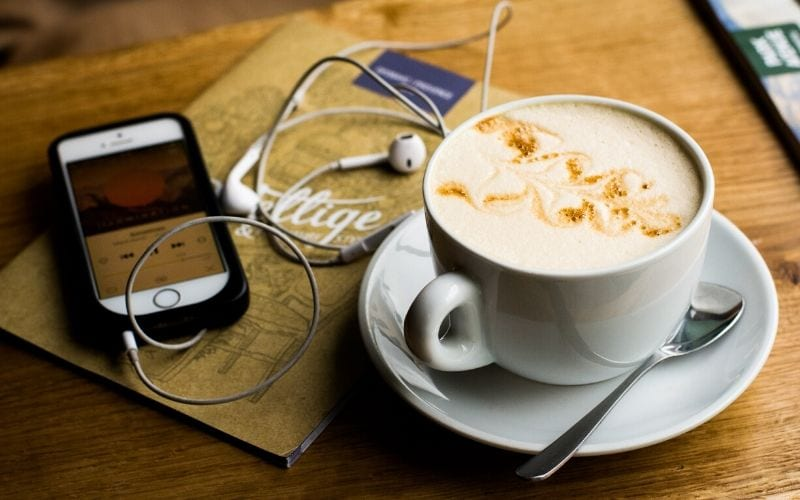 podcast on a phone in a coffee shop