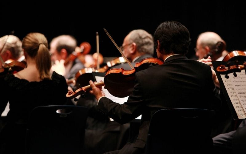 orchestra with violins