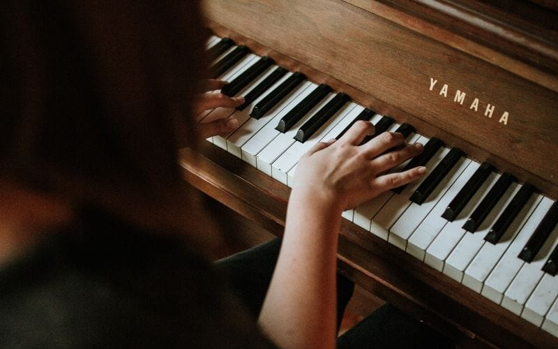 woman playing piano chords