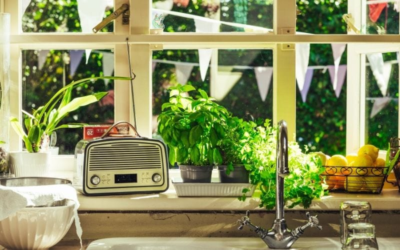Radio on windowsill in kitchen playing Magic Radio