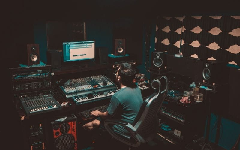 recording engineer in studio using mono and stereo