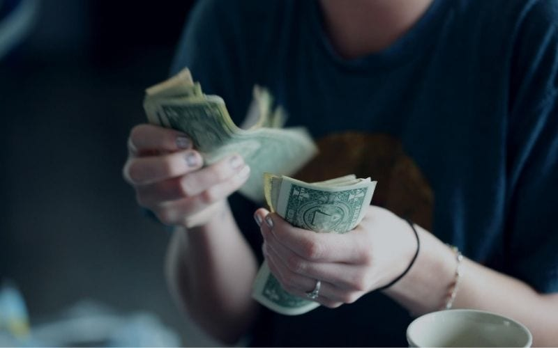 counting money dollars