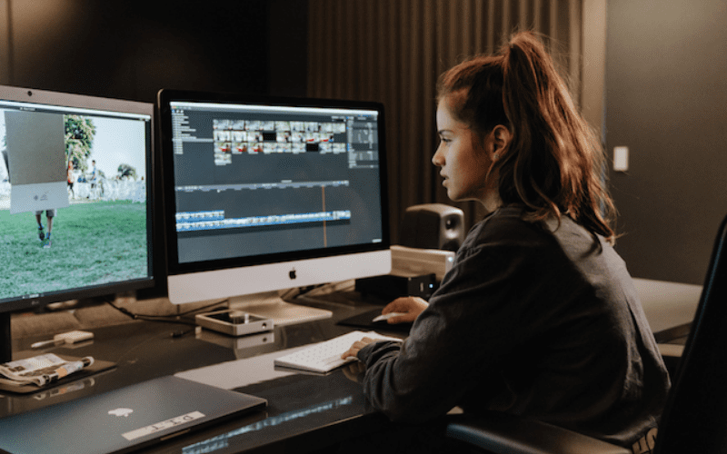 girl working on full time filmmaker computer editing