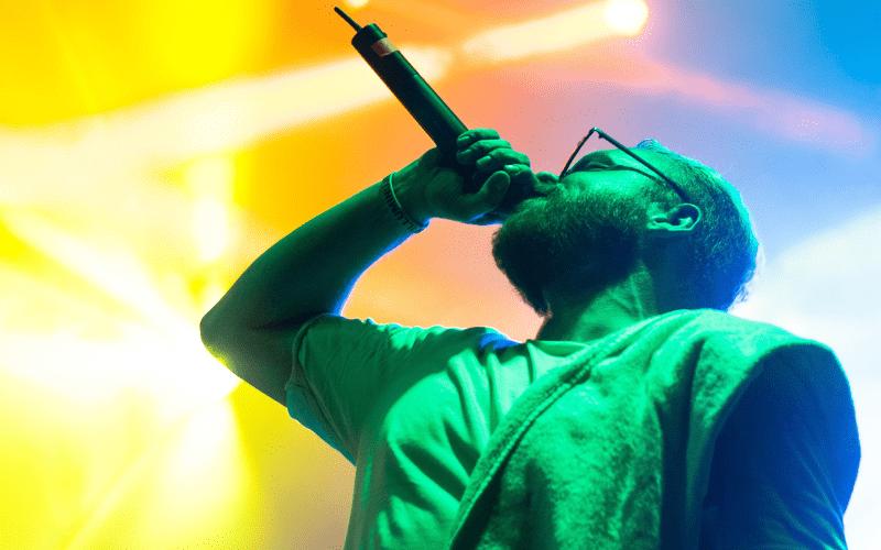 rapper on stage singing