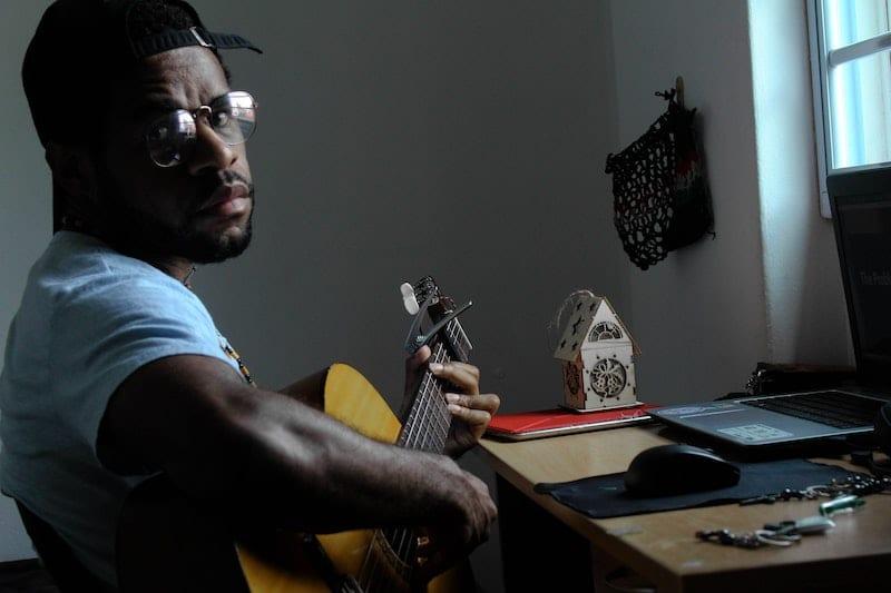 man playing guitar looking at camera using bandapp