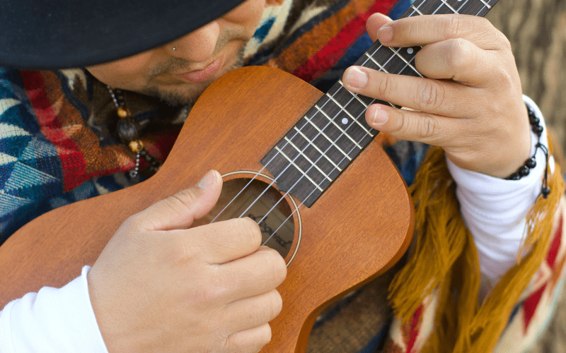 man playing ukulele chords
