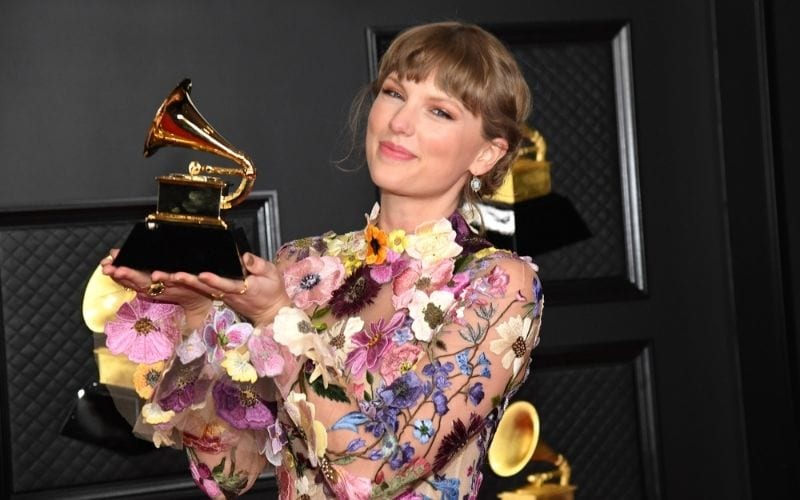 Grammy Winner Taylor Swift at the Grammys 2021 in flower dress holding an award