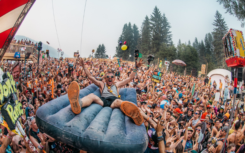 man crowd surfing at a concert
