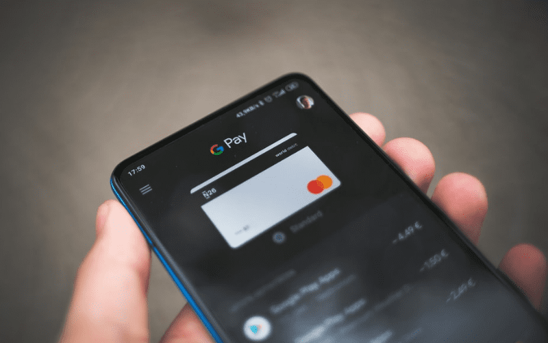 A man using google pay on his phone.